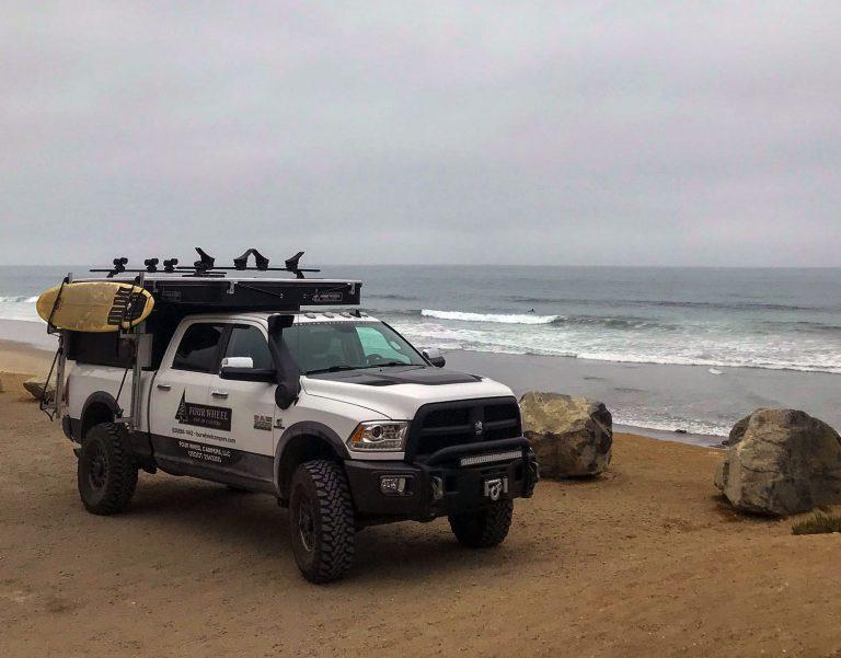 Four wheel Camper with Surfboard on Side near Beach