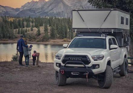 Toyota Popup Four Wheel Camper w Family Near Lake